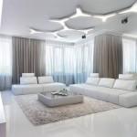 beyaz köşeli koltuklarla dekore edilmiş şık oturma odası